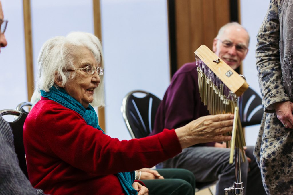 older lady plays instrument in Singing for Memory dementia session at The Point in Doncaster