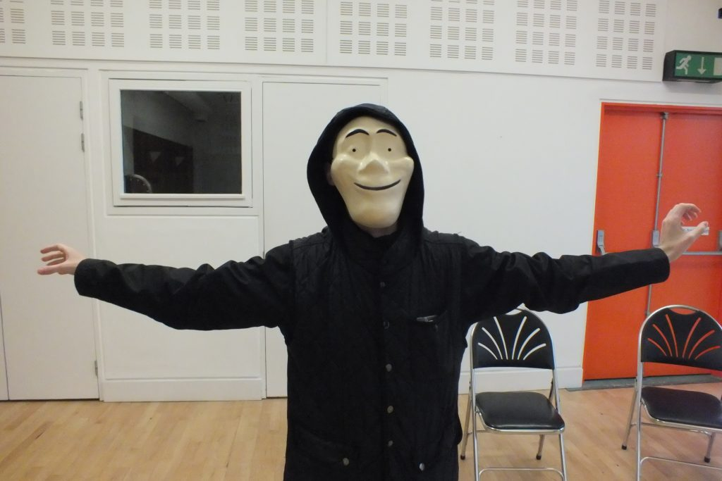 young person wearing a mask doing drama with darts in Doncaster at The Point