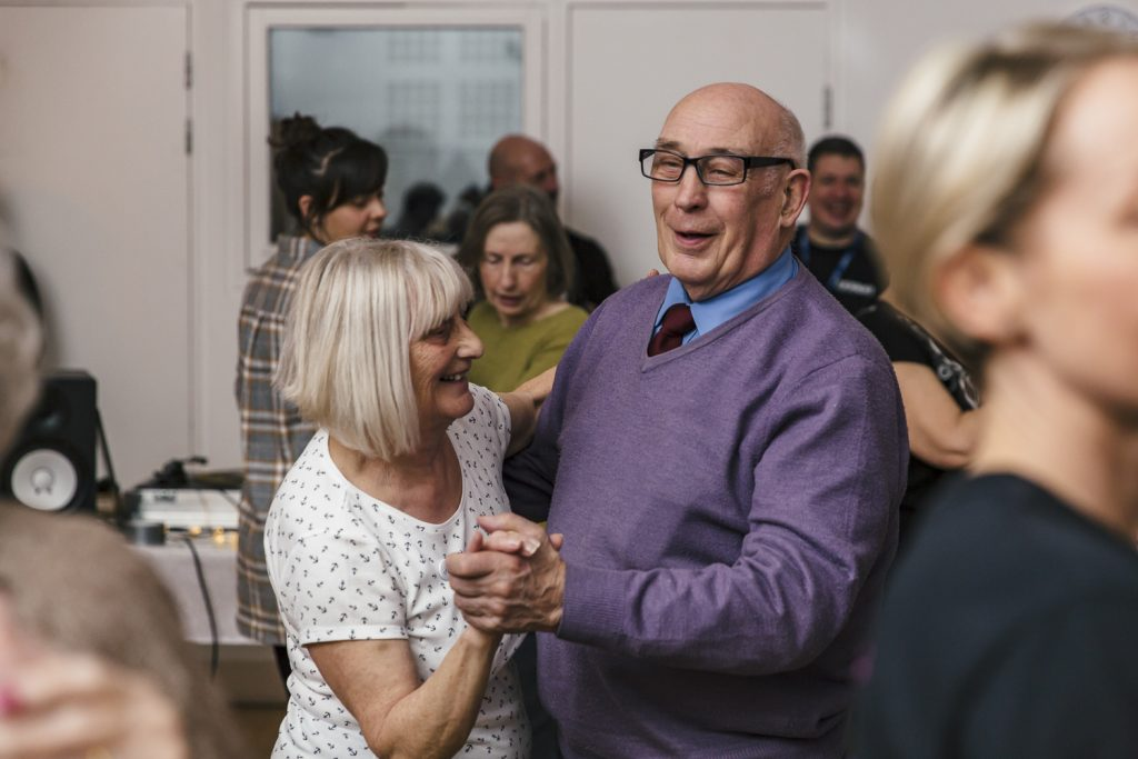 A man and woman smile and dance - Dance On project by darts in Doncaster