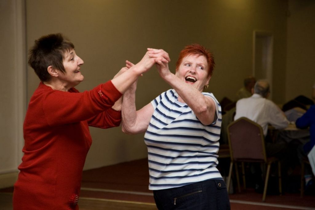 Two women dancing and smiling - Dance On darts in Doncaster