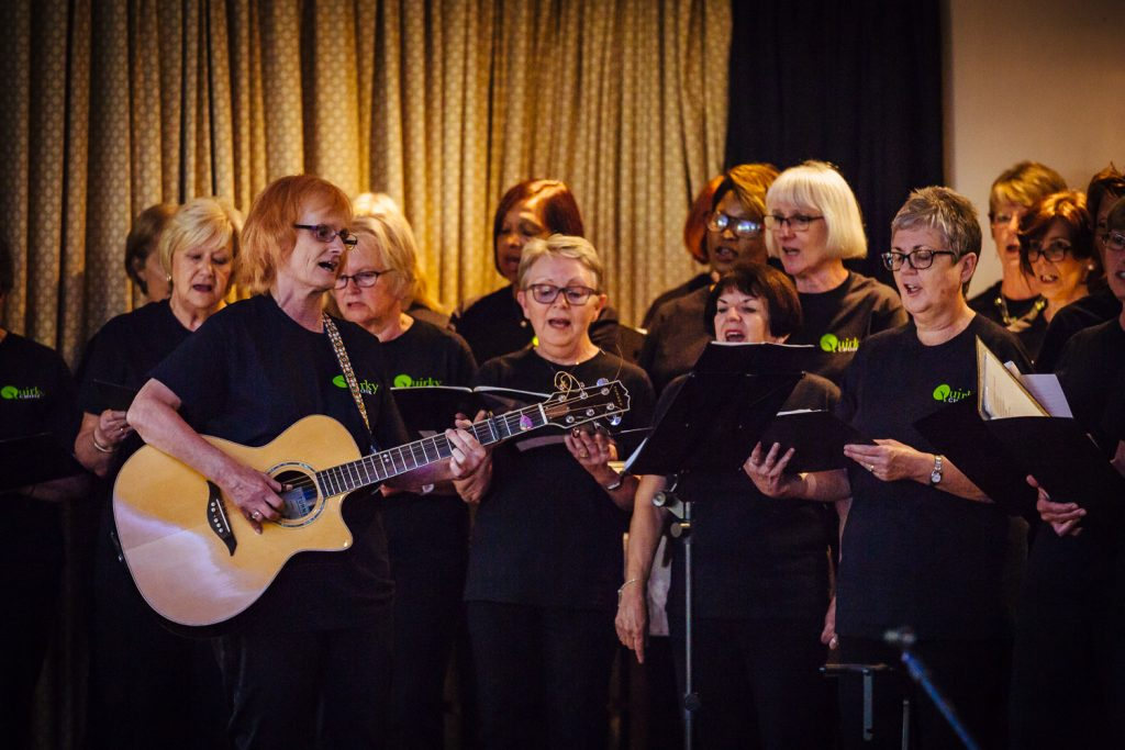 Musician Janet Wood sings with members of the Quirky Choir