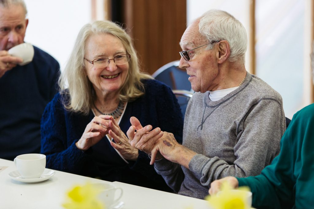 A man and a woman using Makaton during a Singing for Memory dementia session at The Point in Doncaster