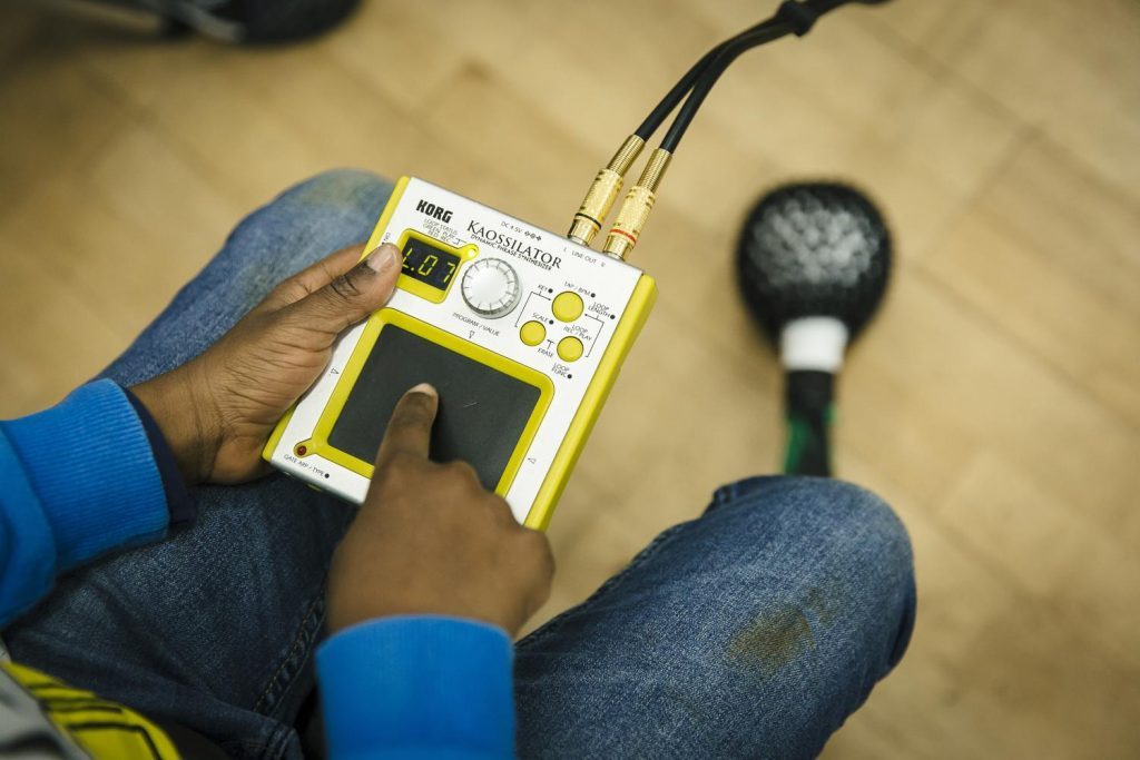 A boy using a piece of electronic equipment at a darts music workshop in Doncaster.