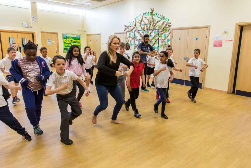 A dance artist leads a group of children in community arts activities with darts in Doncaster