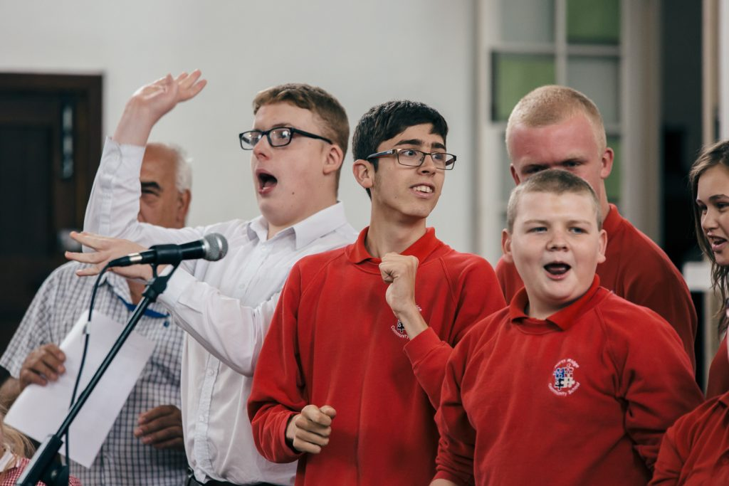 Young people with disabilities singing