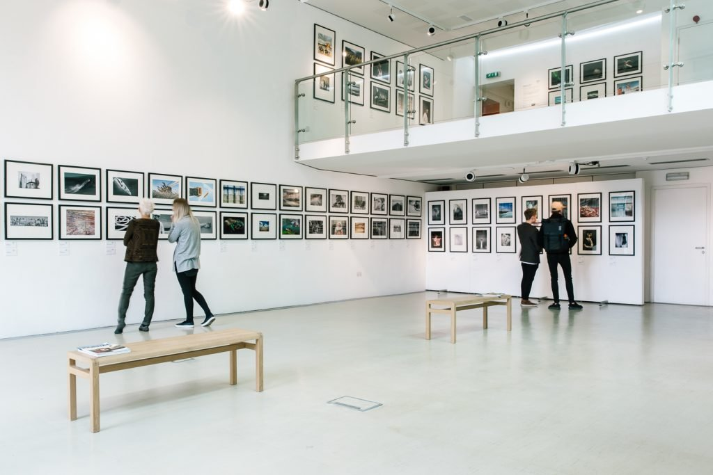 large gallery space with lots of photographs on the wall