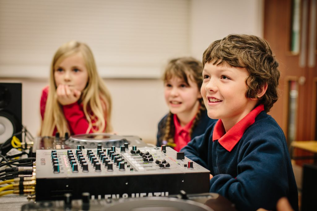a group of children with some music tech equipment at The Point in Doncaster
