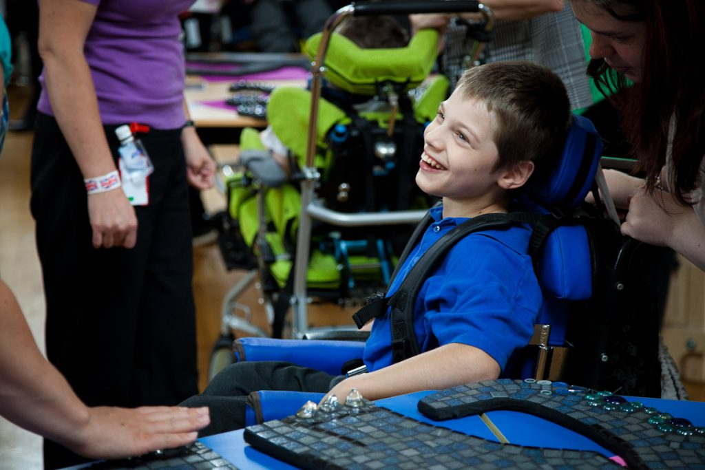 Boy in a wheelchair smiling
