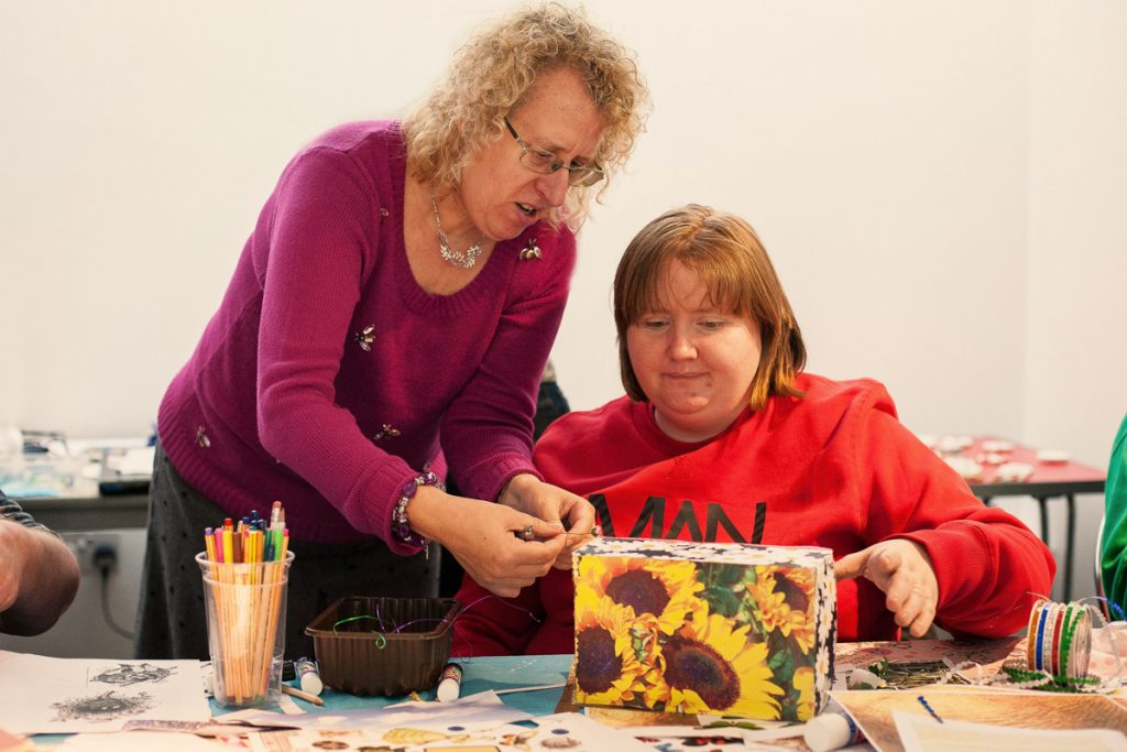 Women taking part in art activity at Creative Directions led by darts Doncaster