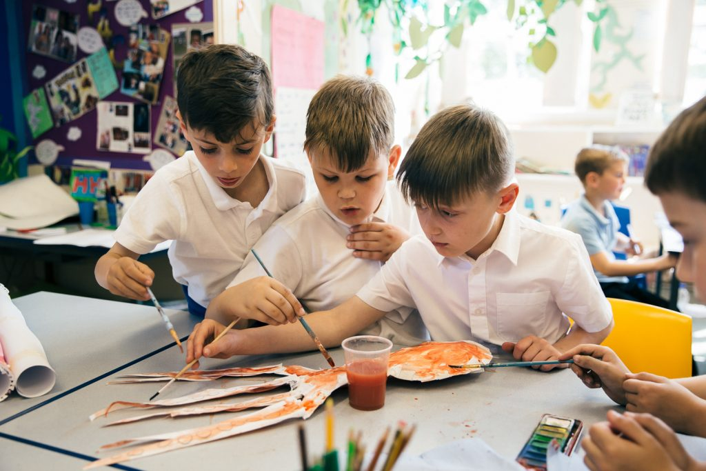 schoolboys painting an octopus as part of a darts in Doncaster schools project