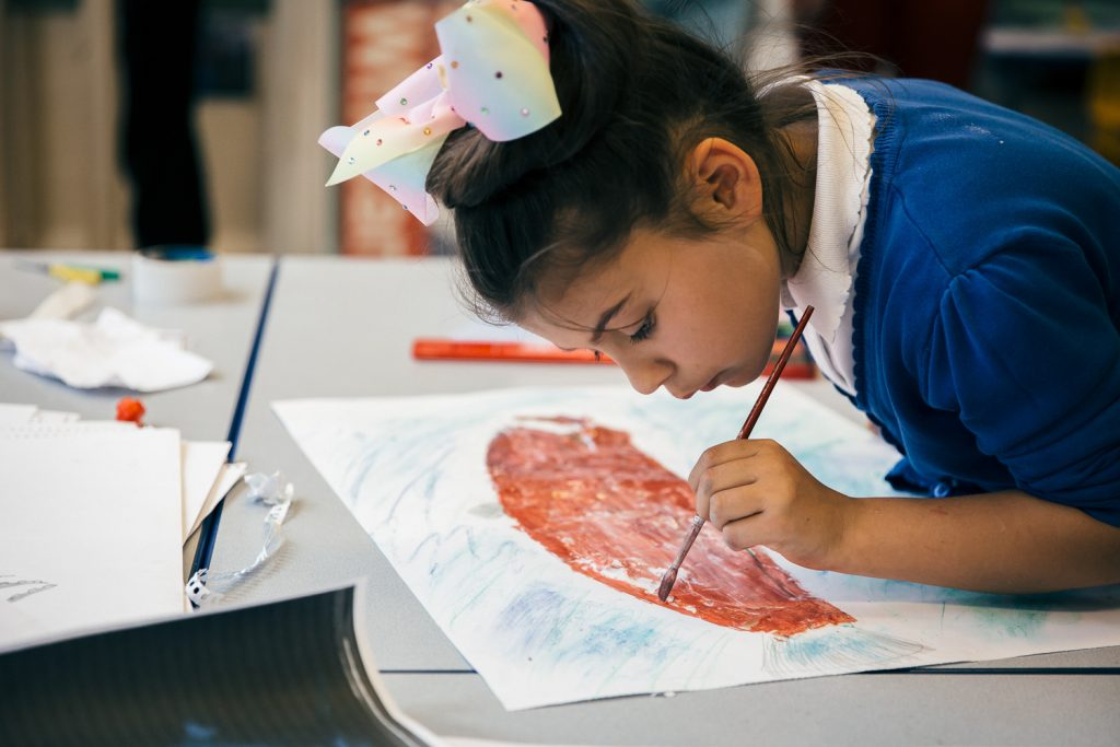 Schoolgirl painting as part of a darts in Doncaster project