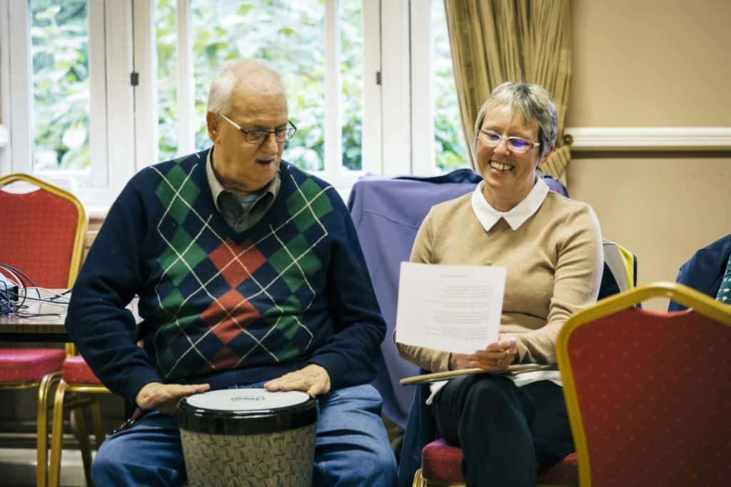 Participants play percussion and sing at a Creative Directions session in Askern - darts in Doncaster