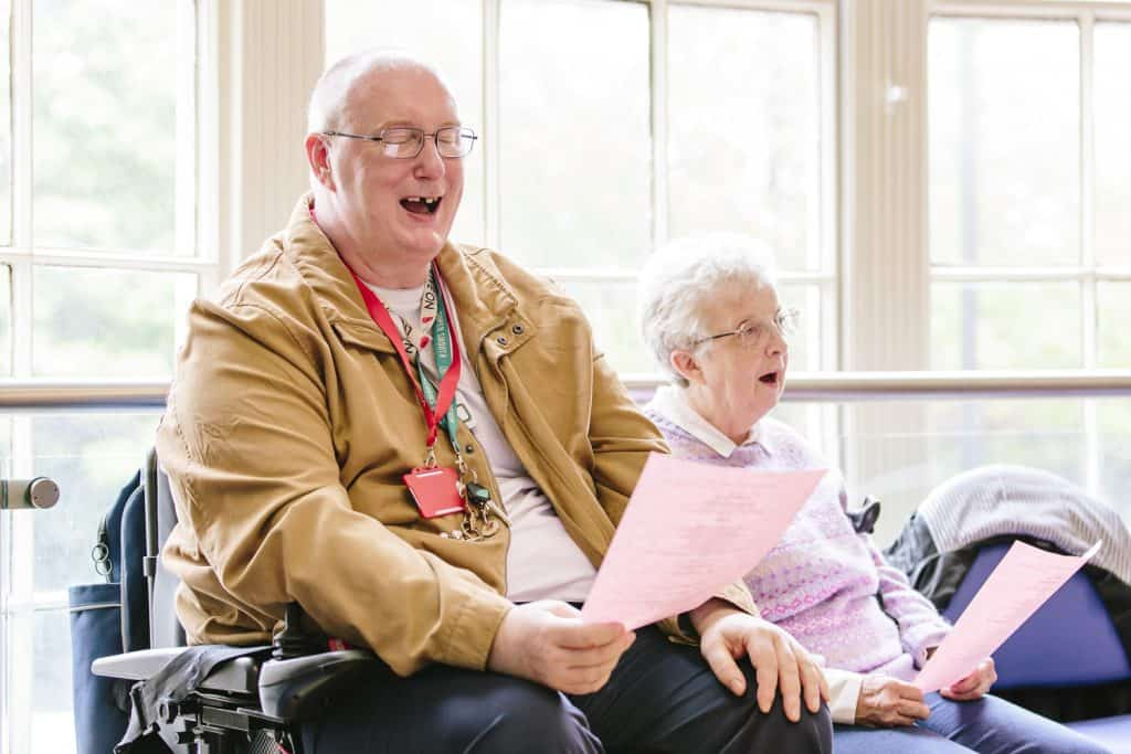 Man and woman sing joyfully - Creative Directions group - darts in Doncaster