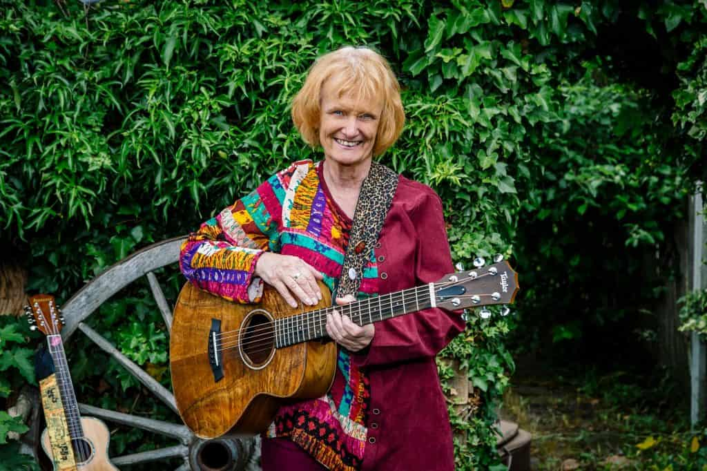 Musician Janet Wood in her garden with guitar and ukulele for darts in Doncaster wearedarts