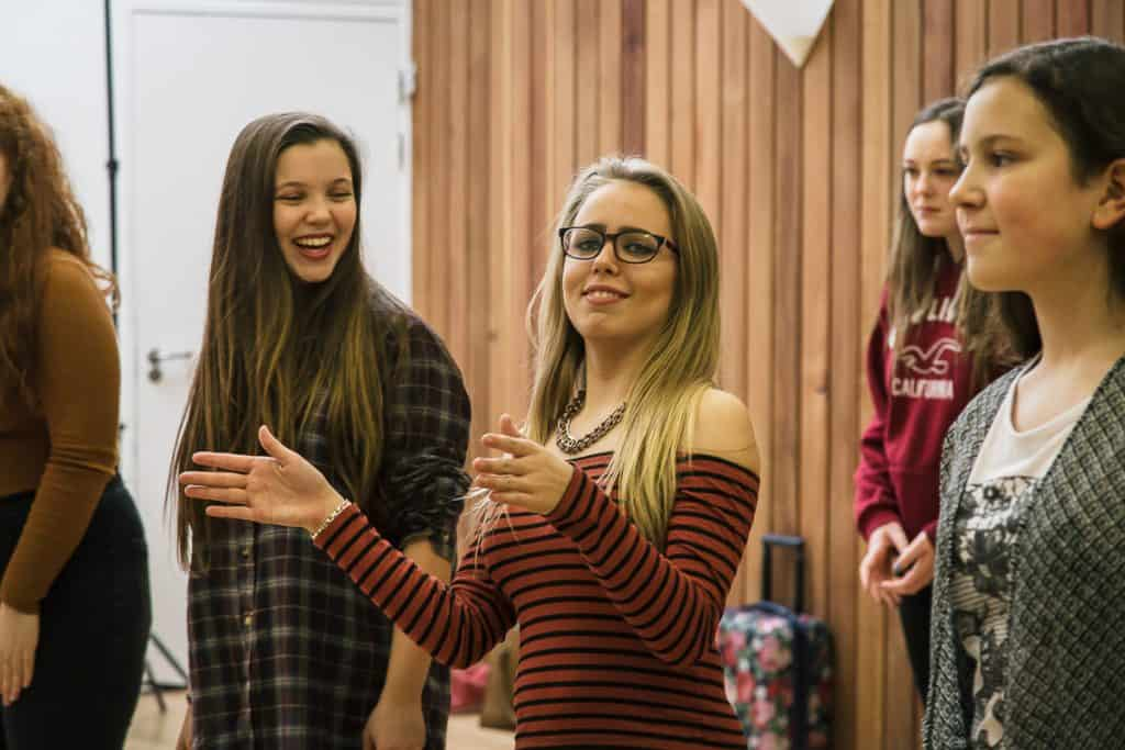Three girls having fun at darts' Swag Choir at The Point