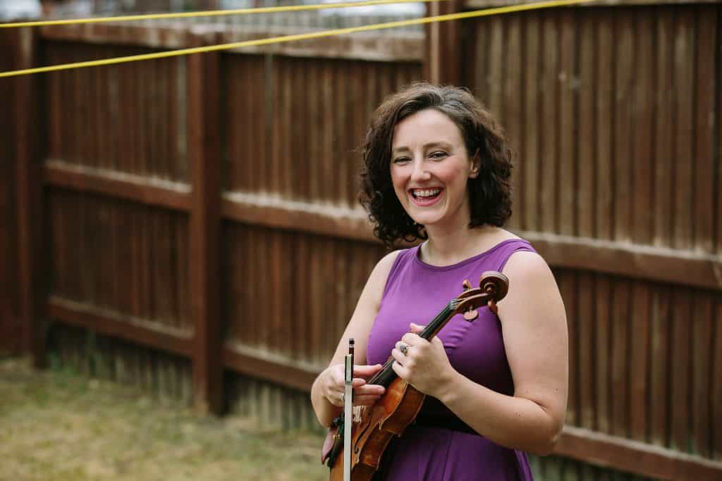 Musician Dyzelle Sutherland at home with her violin for darts in Doncaster