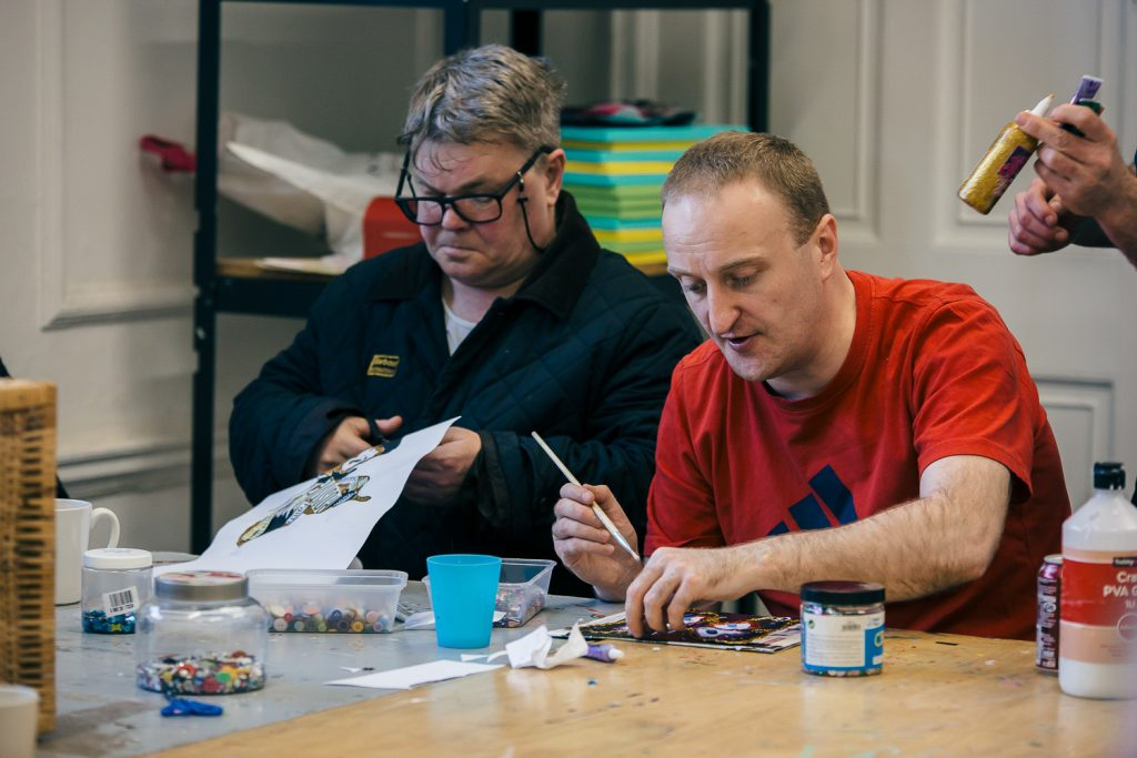 Two men doing arts and crafts in a Creative Directions session at The Point.