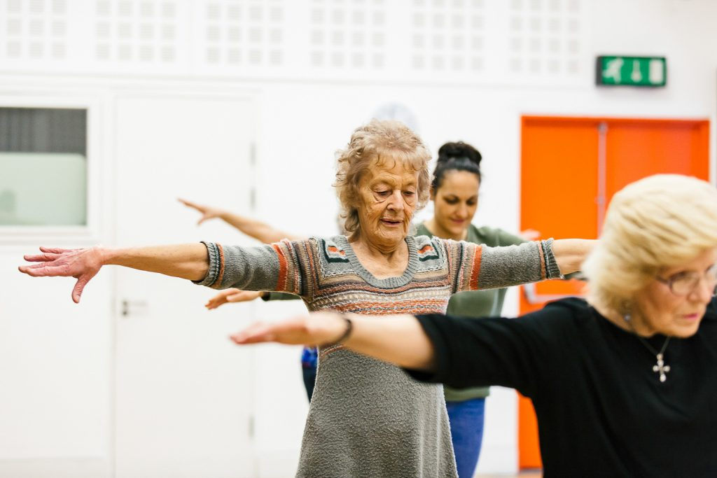 Three women stretching their arms out at a Dance On session in Doncaster.