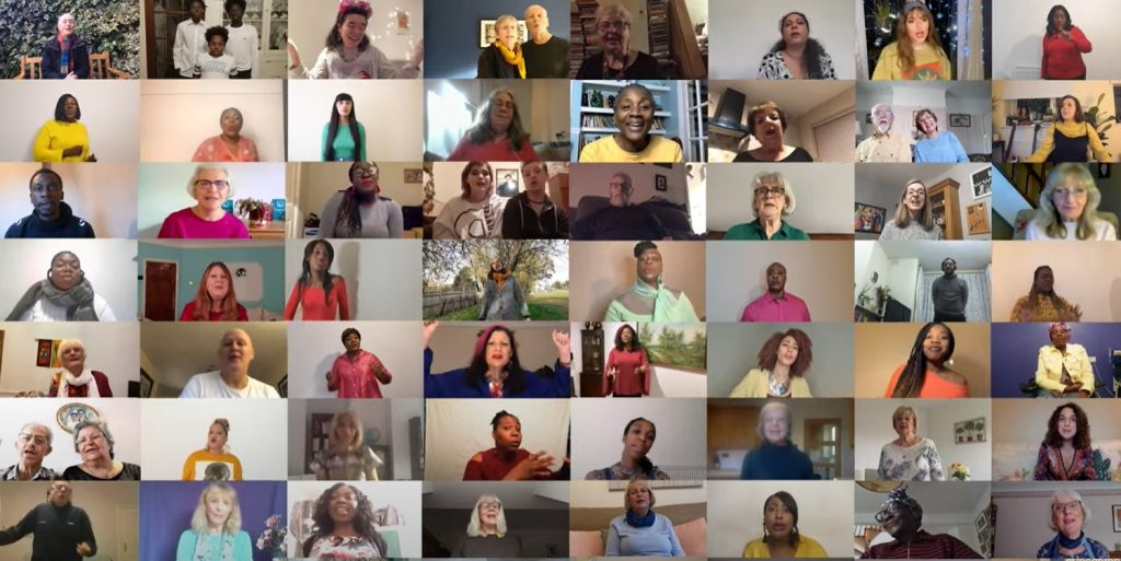 Lots of faces of people singing on zoom - darts participants join National Theatre and Guardian singing project