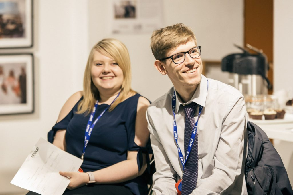 A man and a woman smile while taking part in a teacher training session at The Point in Doncaster